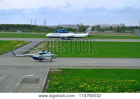 The Mil Mi-8 AMT helicopter after landing and Transaero Airline Boeing