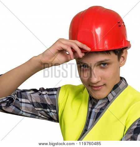 Young Builder In Vest And Helmet