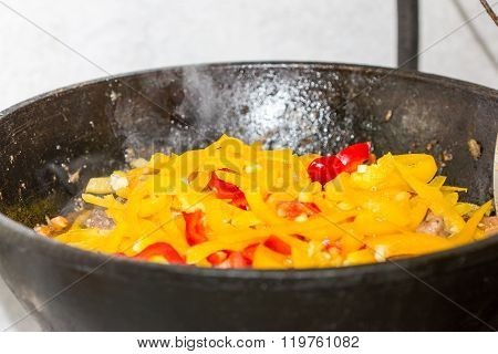 Meat With Onion And Paprica  In A Cauldron On Fire