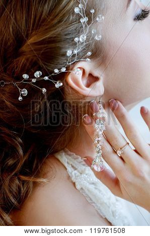 Bridal Jewelry Closeup. Woman Wearing Engagement Ring, Earrings And Headpiece.