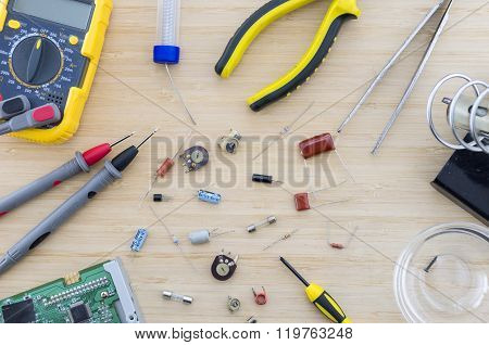The Radio Parts And Tools On The Wooden Table.