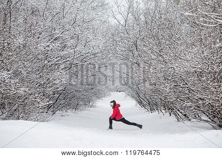 Young Woman Doing Stretching Exercises During Winter