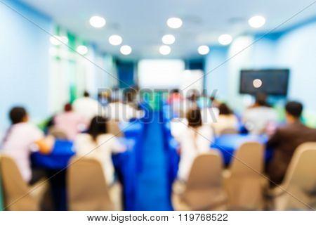 Blurred People In Seminar Room