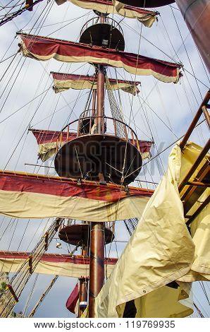 The main mast of a sailing ship.