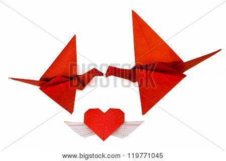 Origami birds from red vintage paper.. Birds love. Birds kiss.