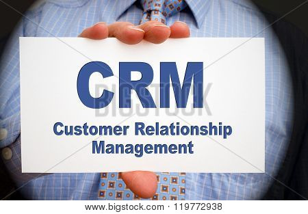 CRM - Customer Relationship Management - Businessman with sign and text