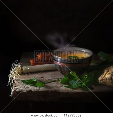 Steaming Vegetable Soup And Ingredients On A Rustic Wooden Table, Dark Background, Copy Space