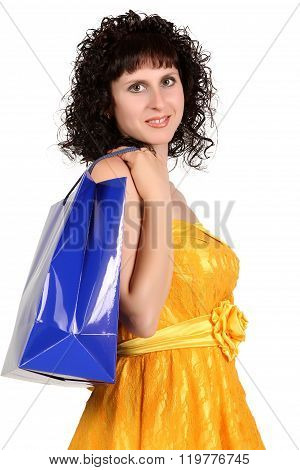 Brunette In A Yellow Dress With Shopping Bag