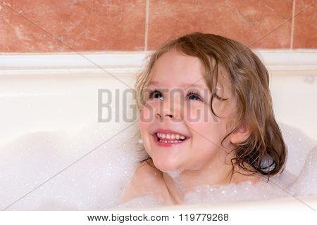 Little Girl Bathes In Bathtub With Foam