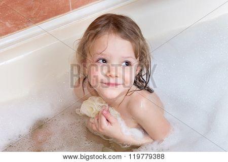 Little Girl Taking Bath With Foam