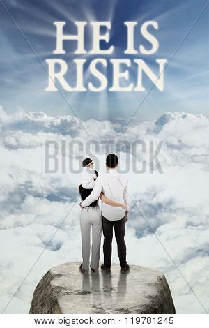 Christian Family Look At Text He Is Risen