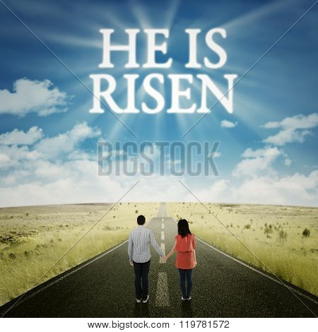 Couple Looking At Text He Is Risen