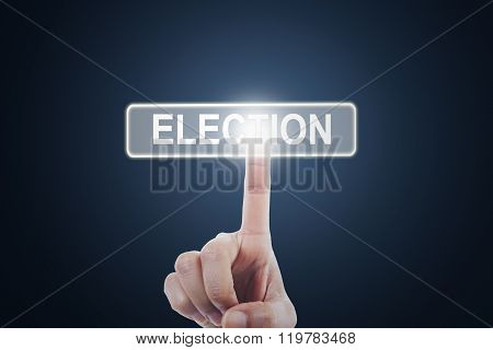 Hand Touching Election Button On The Screen