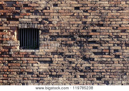 Ancient Brick Wall, Window Locked With Metal Bars