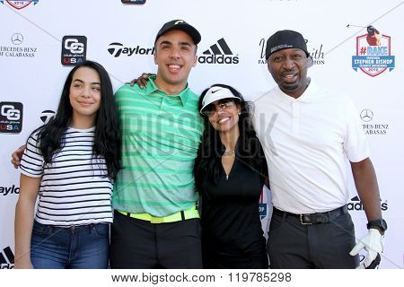 Miah Kidd, Trey Jason Kidd, Joumana Kidd and Ricky Smith  arrive at the inaugural Stephen Bishop celebrity golf invitational for R.A.K.E. on Feb. 15, 2016 at Calabasas Country Club in Calabasas, CA.