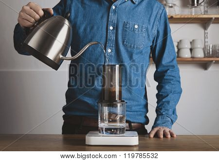 Barista Pours Hot Water To Aeropress