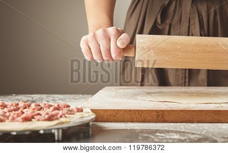 Flatten Dough With Wooden Rolling Pin