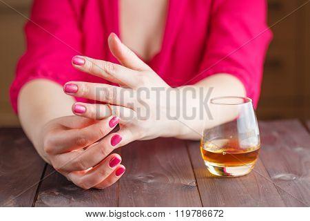 Woman Take Off Wedding Ring