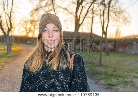 Young Hipster Girl Outdoors At Sunset