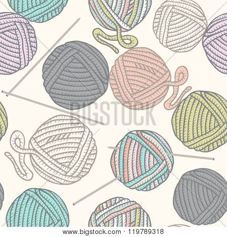 Seamless pattern with balls of yarn and knitting needles. Background in cartoon style.