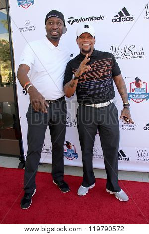 Ricky Smith and D.L. Hughley arrive at the inaugural Stephen Bishop celebrity golf invitational benefiting R.A.K.E. on Feb. 15, 2016 at Calabasas Country Club in Calabasas, CA.