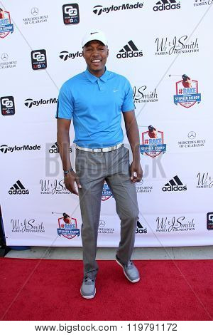Flex Alexander arrives at the inaugural Stephen Bishop celebrity golf invitational benefiting R.A.K.E. on Feb. 15, 2016 at Calabasas Country Club in Calabasas, CA.