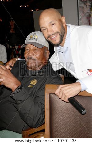 Jim Brown and Stephen Bishop at dinner for the Iinaugural Stephen Bishop celebrity golf invitational benefiting R.A.K.E. on Feb. 15, 2016 at Calabasas Country Club in Calabasas, CA.