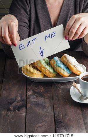 Woman Take Donuts And Hold Message Eat Me