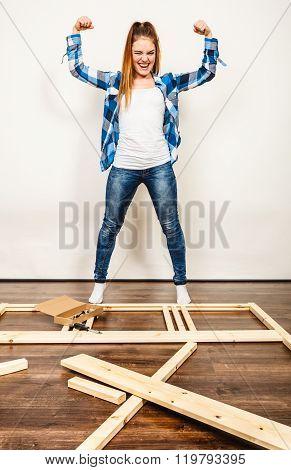 Happy Woman Assembling Wood Furniture. Diy.