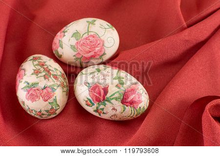 Colorful Decoupage Decorated Easter Eggs On Red