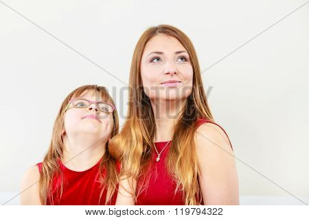 Mother And Daughter Posing Together
