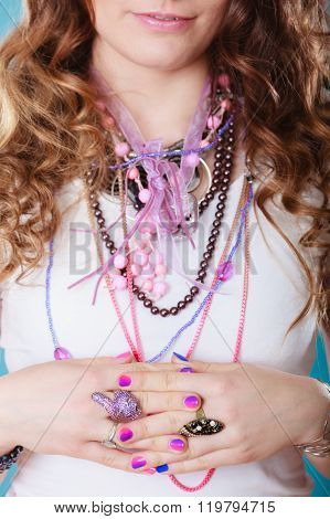 Closeup Of Woman Wearing Jewelry Rings Necklaces.