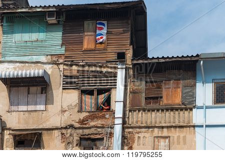 Tumbledown Housing In A Poverty Stricken Section Of Bangkok