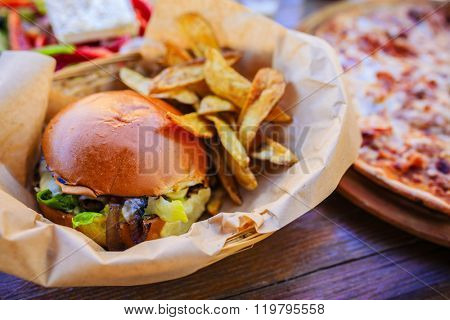 Greek cuisine, burger with roasted potatoes