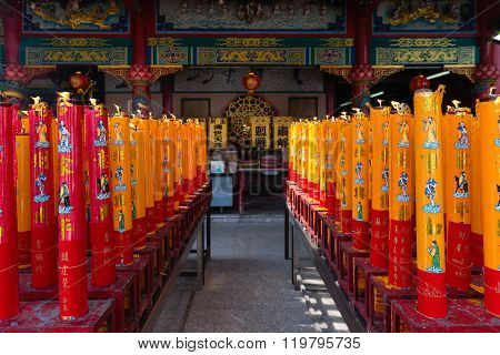Giant Red And Gold Candles Lighted On An Altar Chinese Temple Shrine