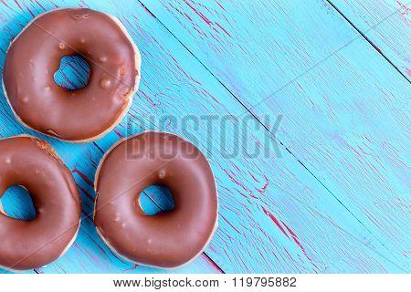Three Crispy Cream Filled Chocolate Donuts