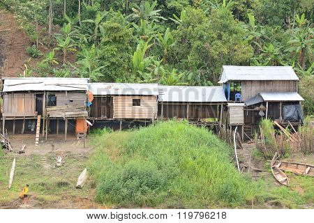 NAUTA, PERU - OCTOBER 14, 2015: Tin Roof Homes near Nauta. Private homes along the banks of the Maranon River in the Peruvian Amazon.