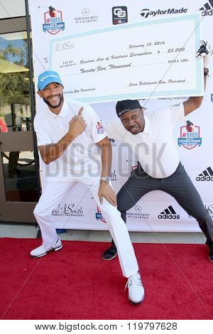 Stephen Bishop and Ricky Smith with a donation (Will and Jada Smith Foundation) at the inaugural Stephen Bishop celebrity golf invitational, Feb. 15, 2016 at Calabasas Country Club in Calabasas, CA.