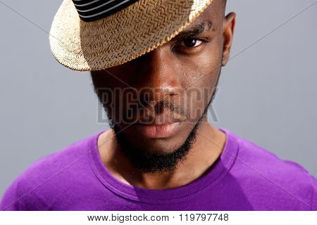 Young African Man Wearing A Hat