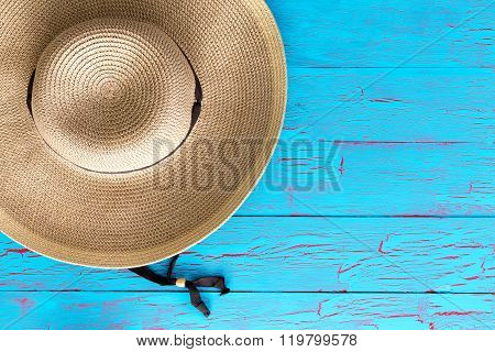 Wide Brimmed Straw Gardening Hat On A Picnic Table