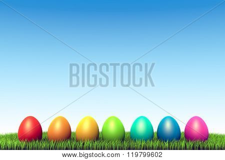 Color eggs row in the green grass Easter background.