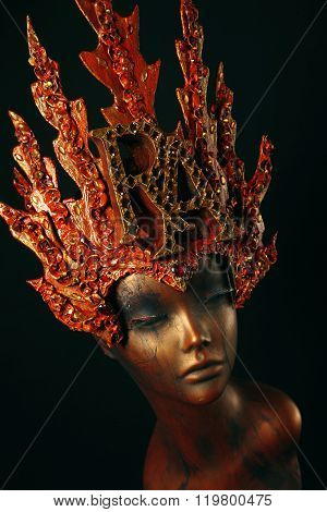 Female Mannequin in red flame headwear  on dark background