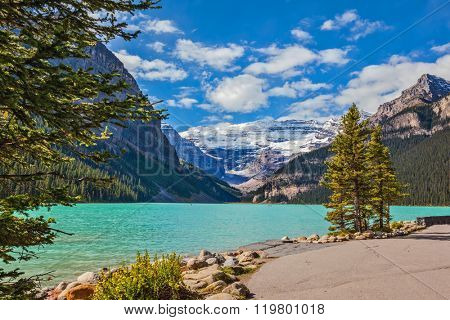 Banff National Park, Rocky Mountains, Canada. The picturesque promenade at Lake Louise. The lake is surrounded by mountains, glaciers and pine forests