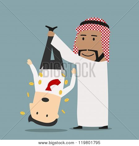 Arab businessman shaking out money