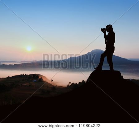Silhouette Photographer At Sunrise