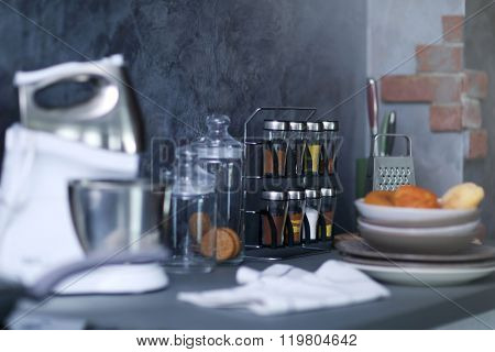 Mixer, utensils and spices on modern kitchen table
