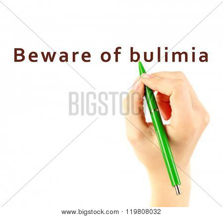 Human hand writing text Beware of Bulimia on transparent whiteboard