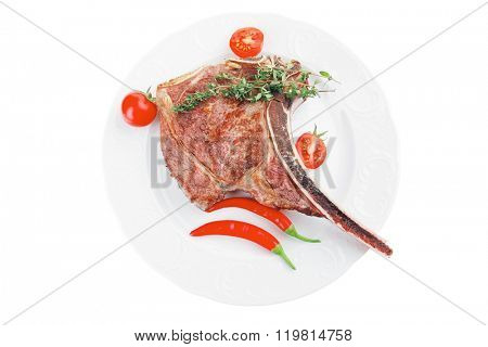 meat food : grilled beef spare rib on white dish with thyme pepper and tomato isolated over white background