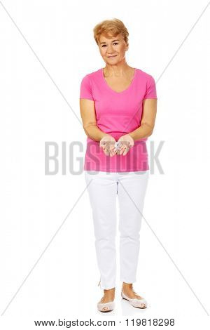 Senior woman with breast cancer awareness ribbon