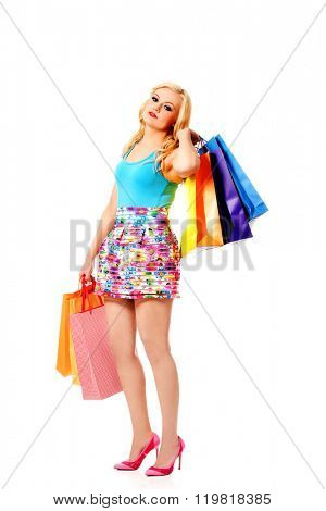 Happy woman holding a shopping bags